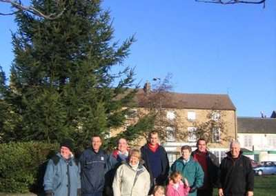 village christmas tree and volunteers